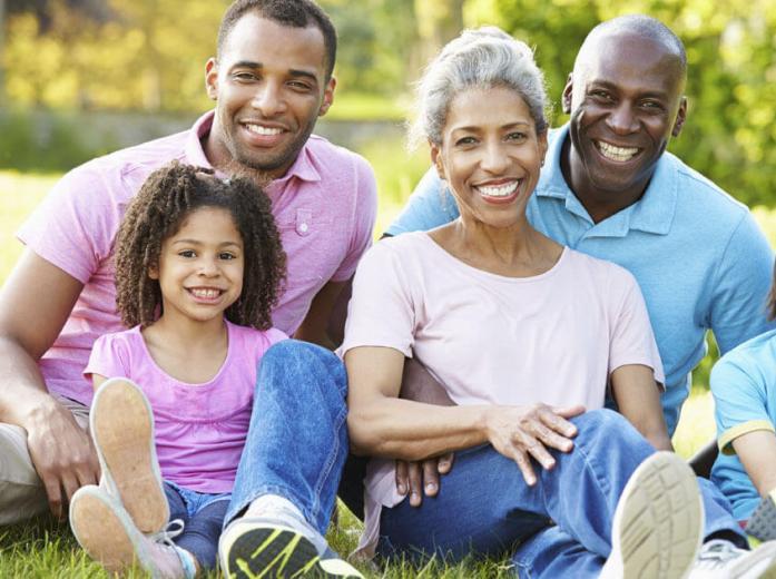 family of 4 smiling