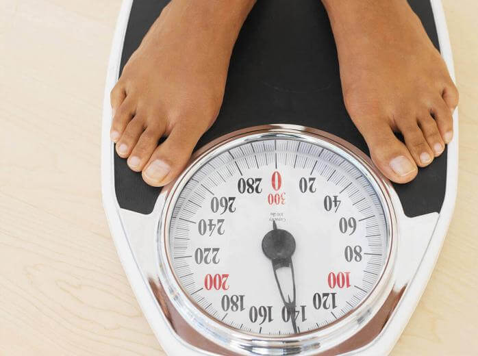 two feet on weight scale
